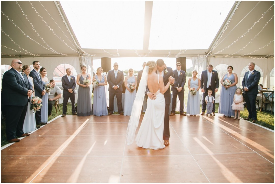Bride and groom dancing under the skylights of white tent. | My Eastern Shore Wedding |