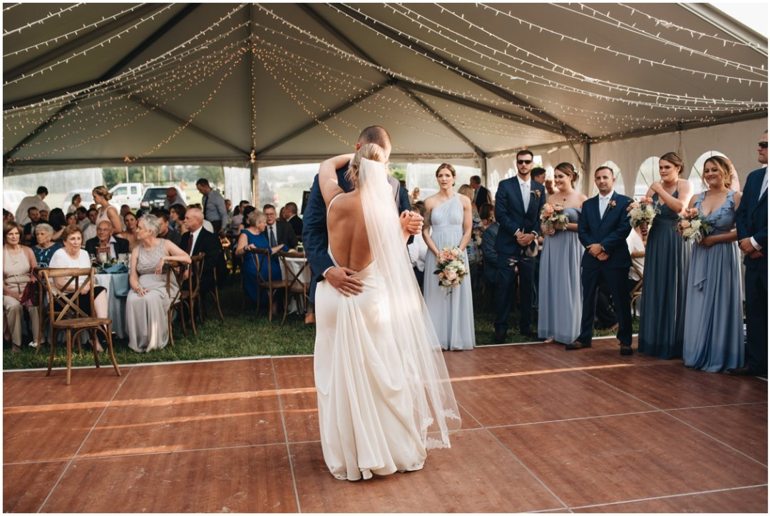 Bride and groom dancing under white tent and string lights at reception. | My Eastern Shore Wedding |