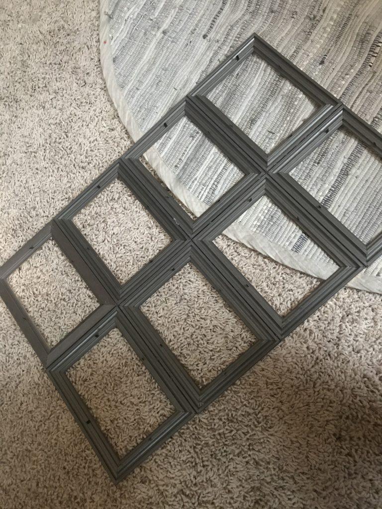 8 dollar tree frames glued together to make a window frame
