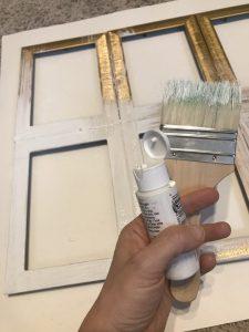 painting the farmhouse window white