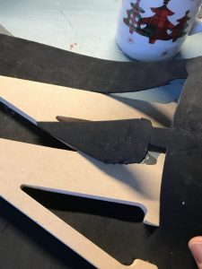trimming foam around wooden letters