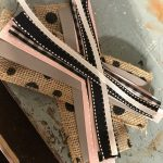 strips of ribbon crossed to make a re-fabbed bow