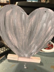 wooden heart painted with several colors
