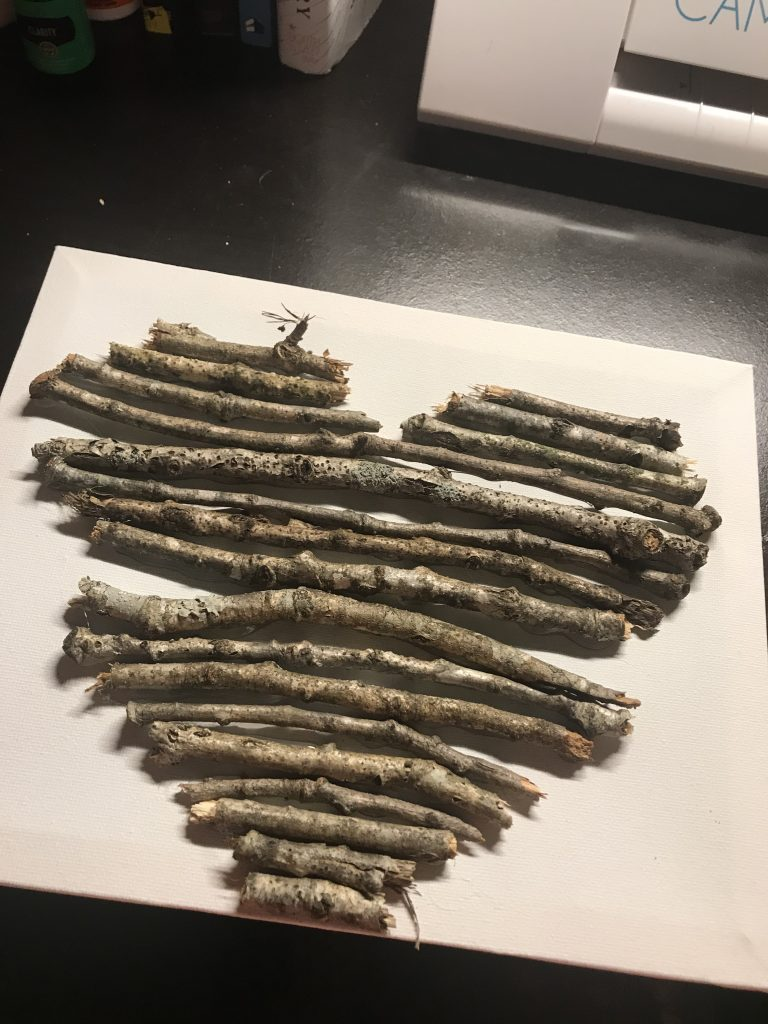 sticks added to a canvas in a heart shape