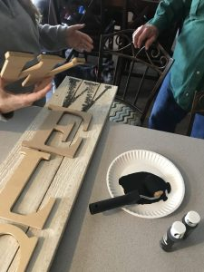 transferring painted letter image to pallet wood sign