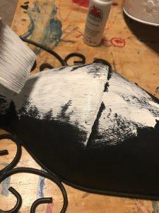 black metal wall vase being painted white