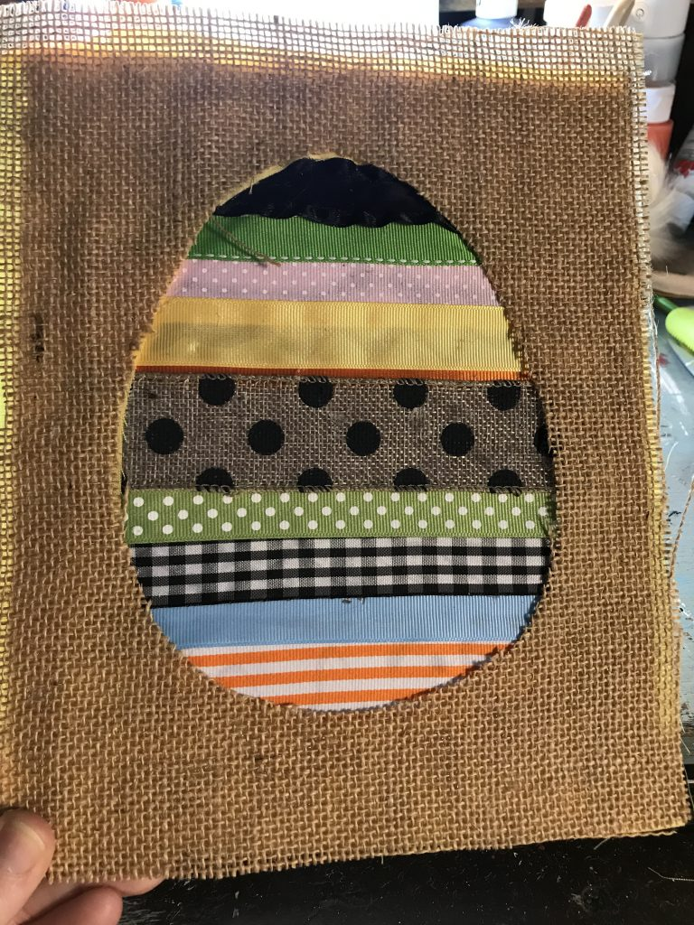 layering burlap fabric over your solid fabric around ribbon easter egg