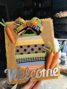 adding twine carrots to ribbon egg canvas