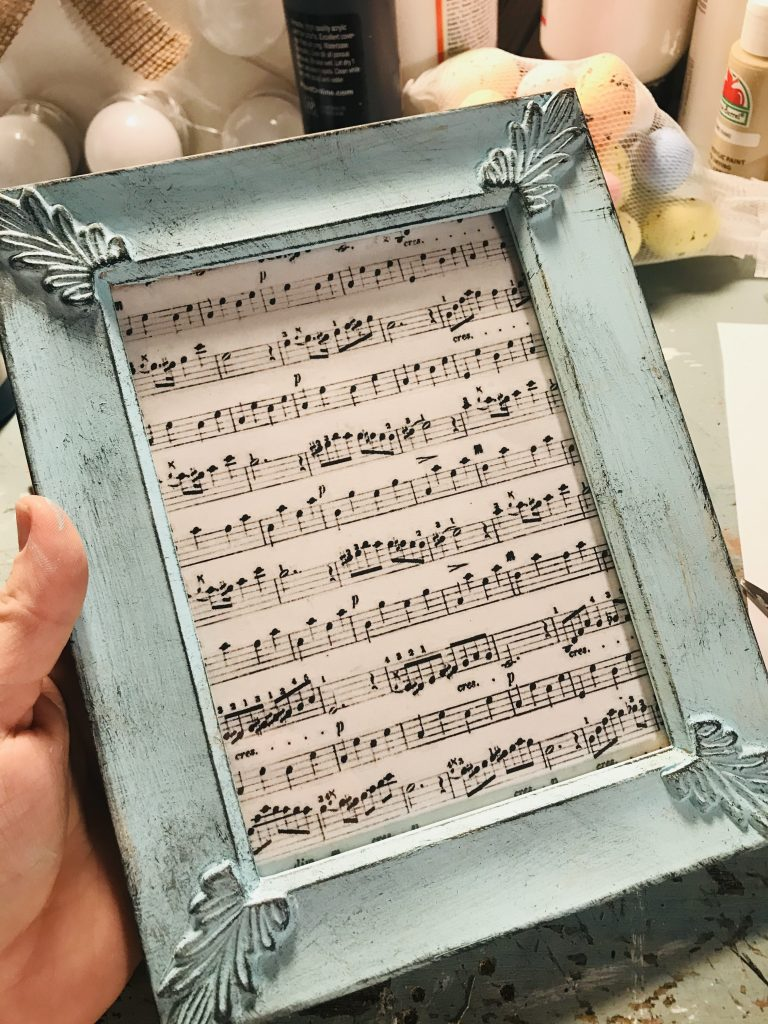 printed sheet music added to blue painted frame