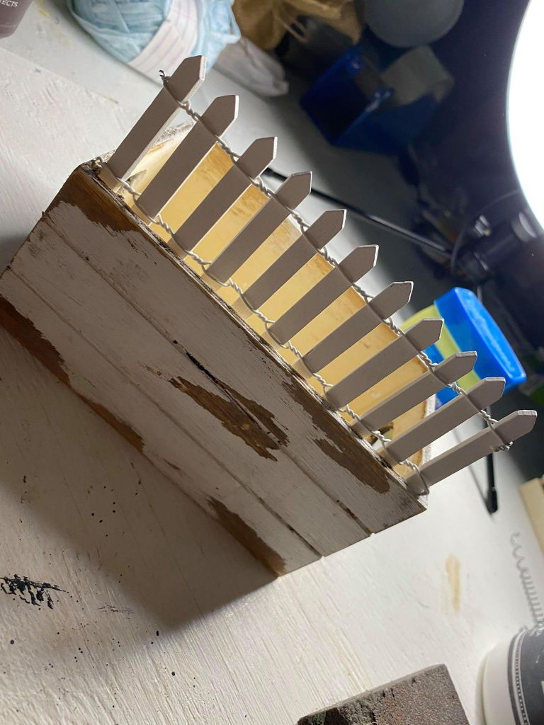 adding fence to a wood crate