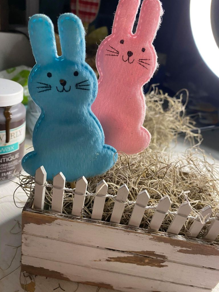adding bunnies to a wooden crate
