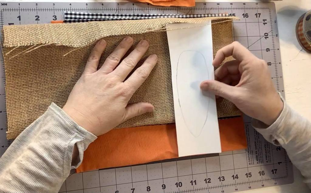 carrot template used to cut out fabric | farmhouse spring carrot garland | carrot decorations | farmhouse Easter decor | ideas for a spring mantel | Easter mantel ideas | spring mantel decor ideas | #eastermantel #carrotgarland