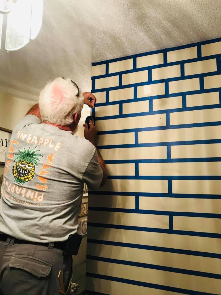 creating a brick design with painters tape for a faux brick wall | #fauxbrickwall