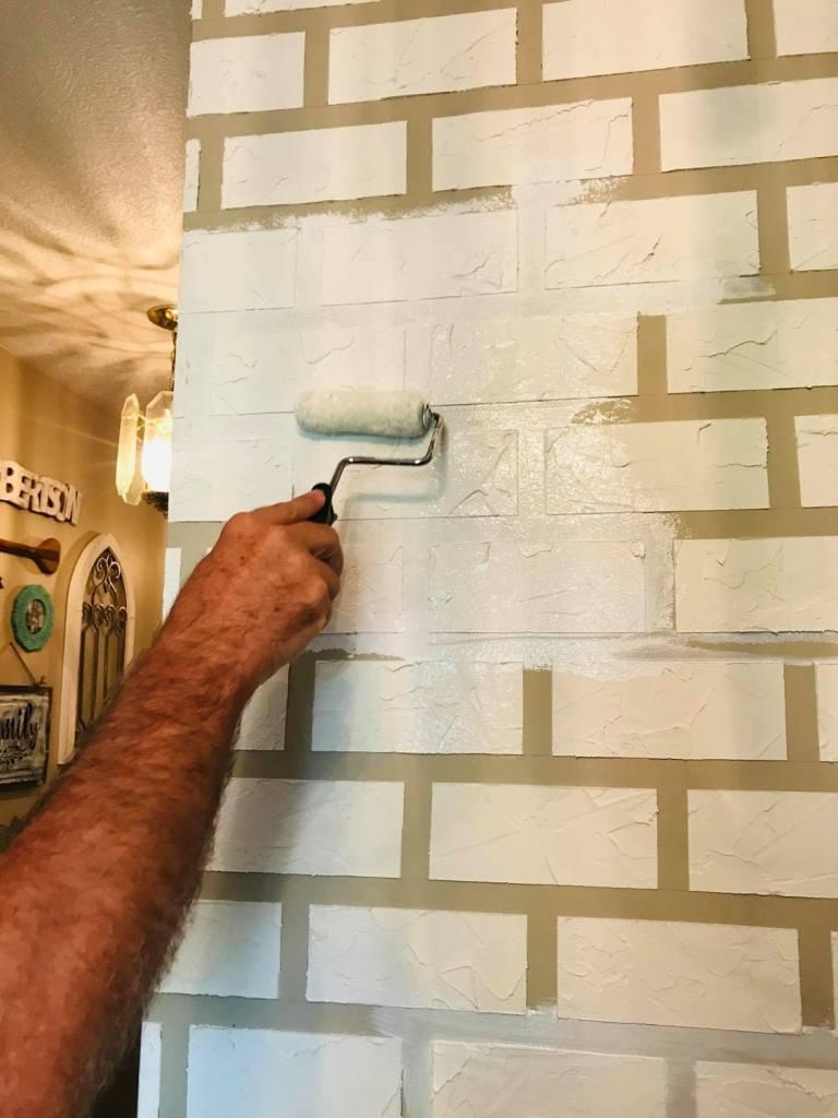 adding paint to faux brick wall | #fauxbrickwall