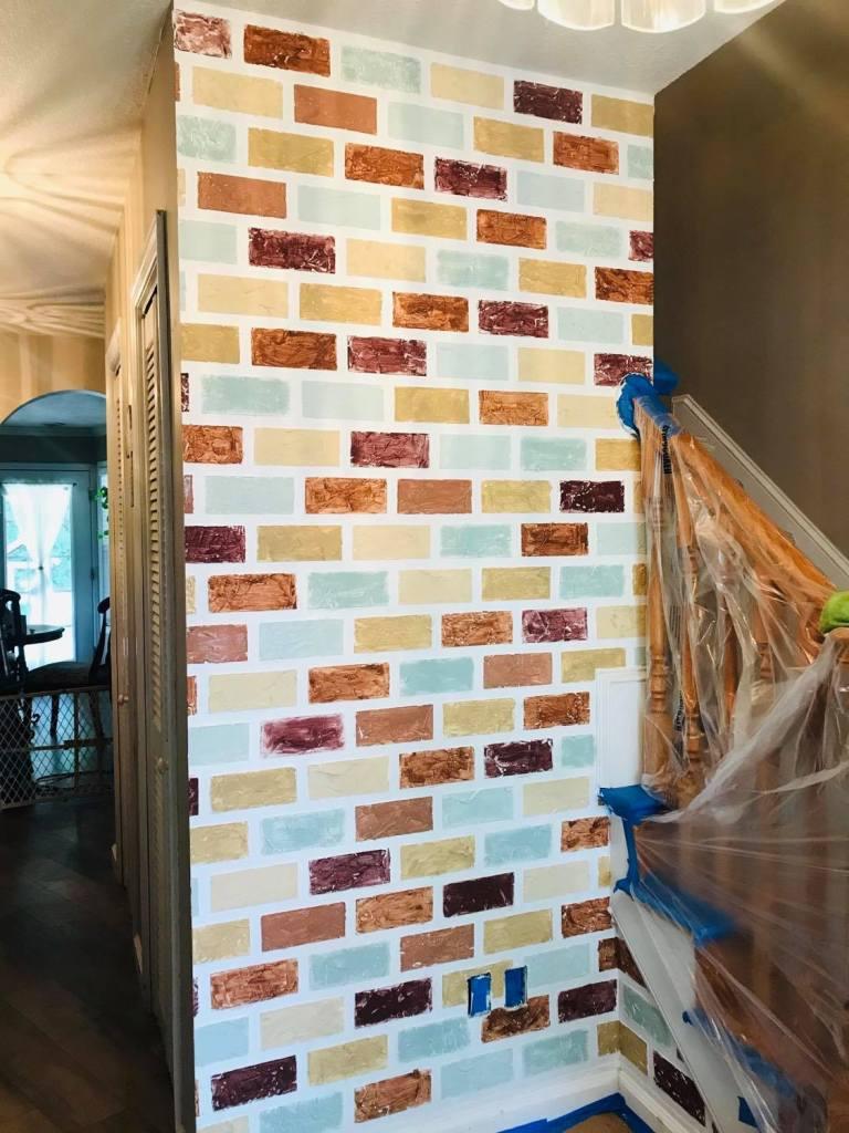"painting the individual ""bricks"" for a faux brick wall design | #fauxbrickwall"