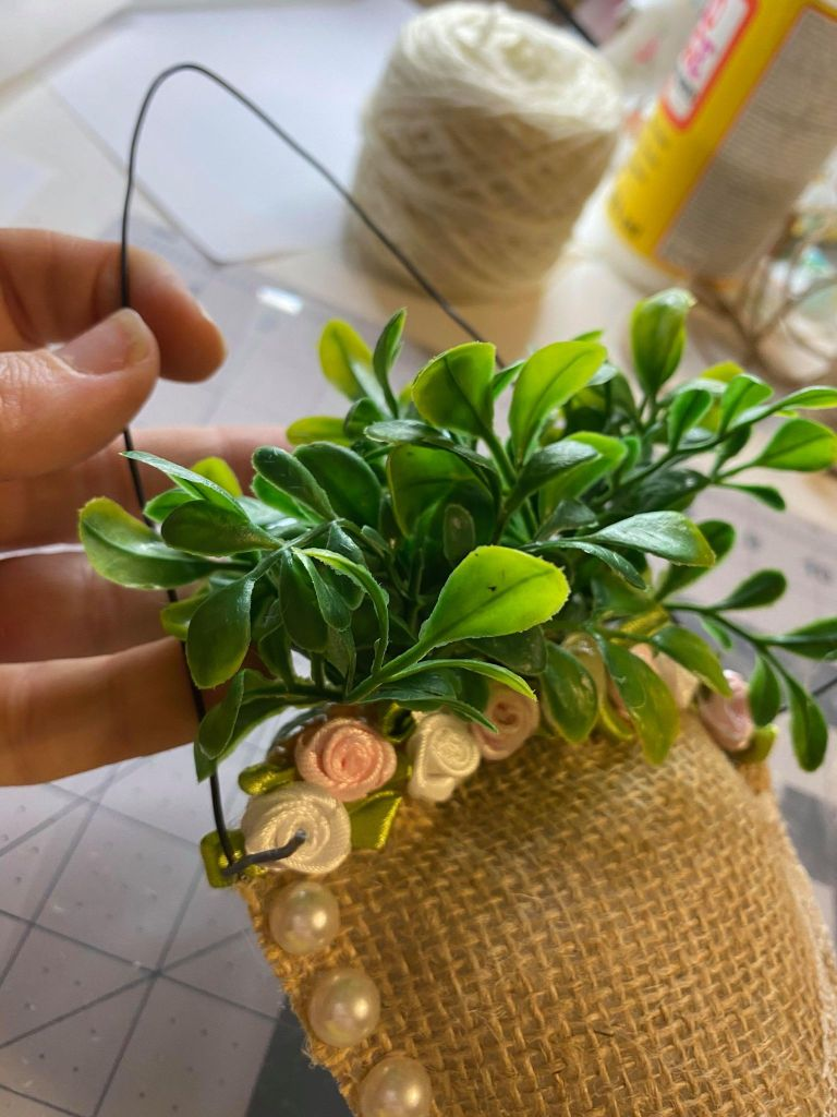 adding a wire hanger to a burlap carrot