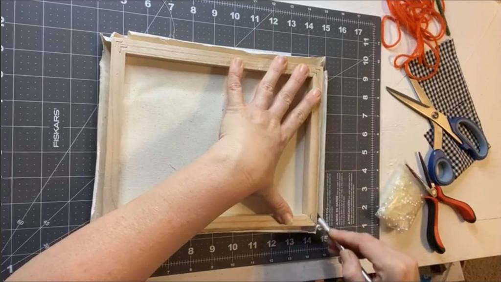 trimming the canvas after removing it from the frame