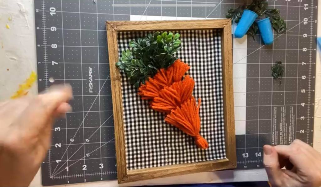 adding the last largest tassel to a carrot craft