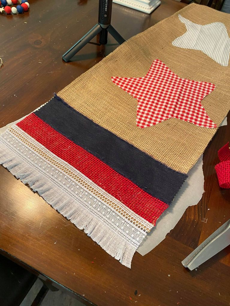 ribbon added to the edge of a burlap table runner