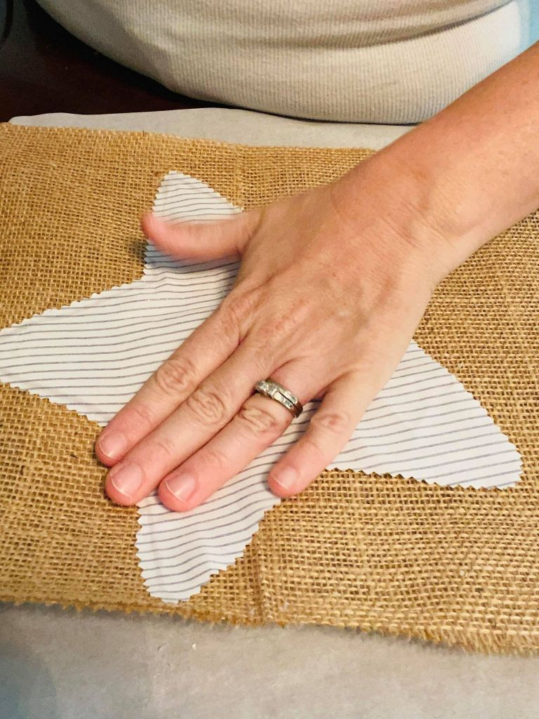 gluing fabric stars to burlap