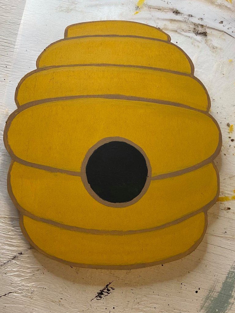 painting a wooden beehive cutout