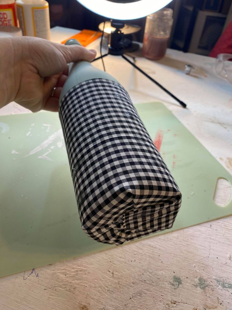 Adding fabric to the bottom half of a wine bottle for a gnome project