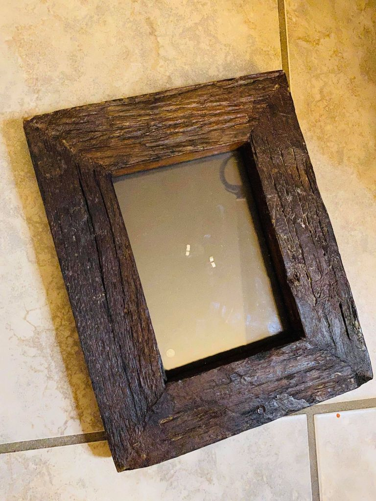 heavy wooden thrifted frame being used for a fall project