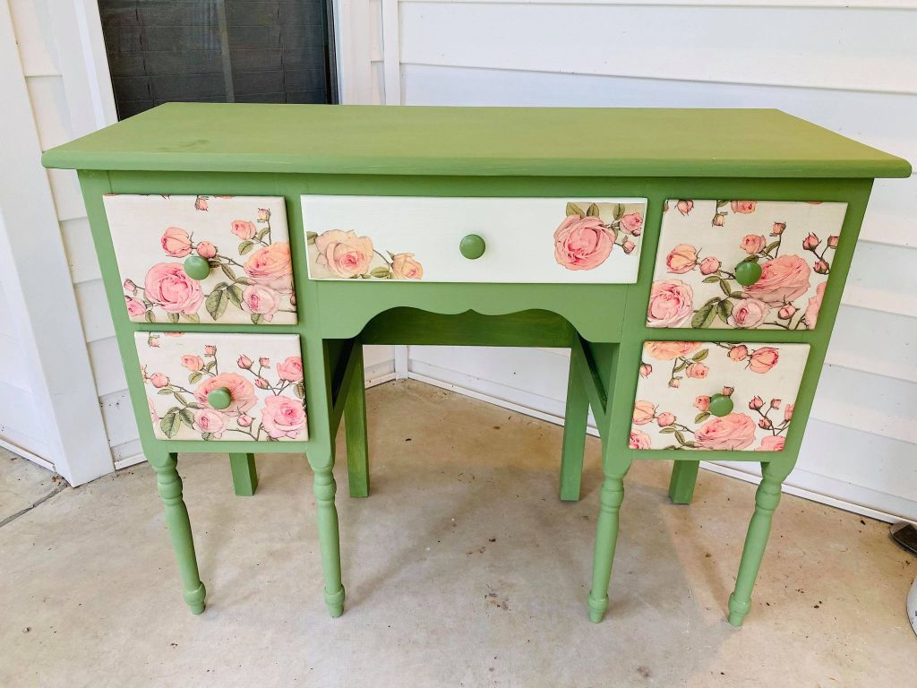 chalk painted vanity table using green chalk paint and a rose napkin to decoupage the drawers