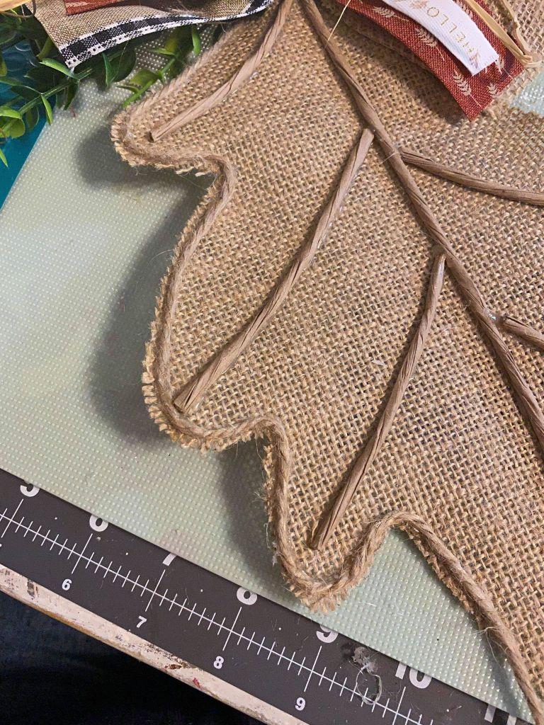 using twine around the edge of a burlap oak leaf