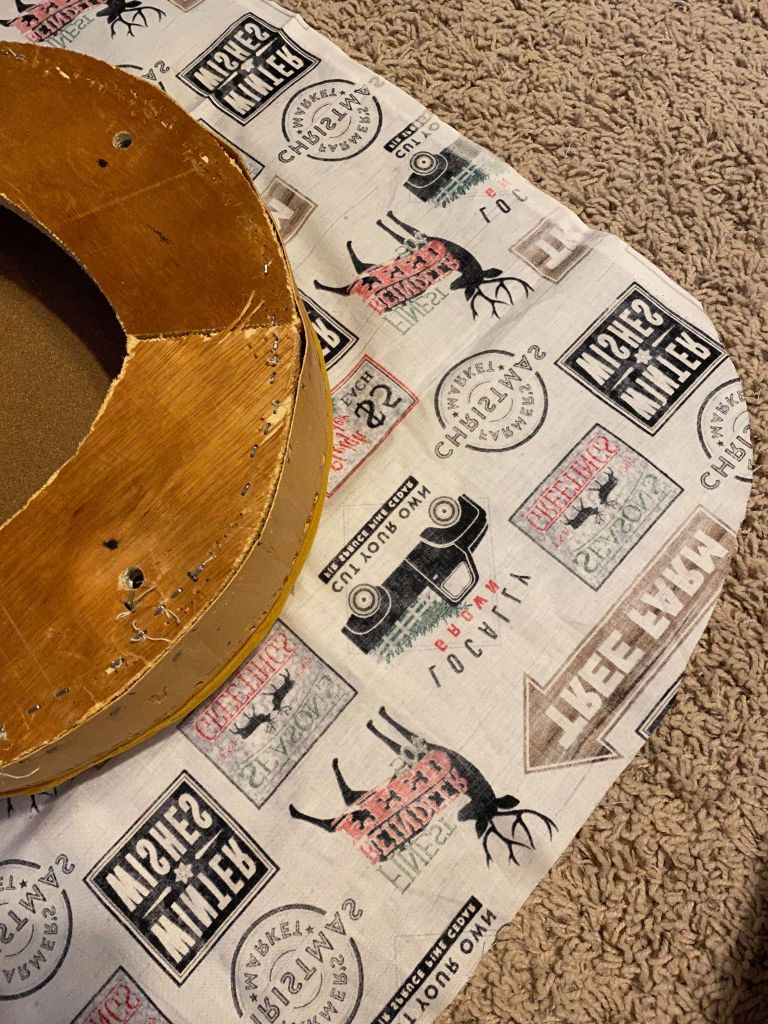 adding new fabric to an old footstool