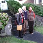 Carole, Tom and Marilyn pose in front of the home before going inside Wednesday morning.