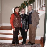 The Jenkins siblings - Marilyn, Carole and Tom - at the bottom of the staircase in their childhood home.
