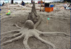 A sandcastle in the grasp of an octopus, from 2012's sand sculpting contest. (Photo by Char Blankenship)