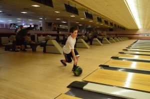 Jackson Metz, 10, participates in Robin Hood's youth bowling program where he receives coaching and is taught the fine points of the game. Here he shows off his form.