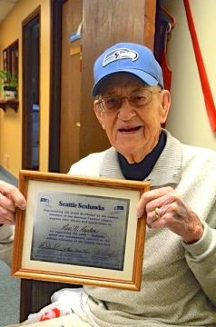 Leo Kepler pauses between activities at the Edmonds Senior Center to show off the certificate acknowledging his 1975 winning entry in a contest to pick a name for Seattle's new professional football team.