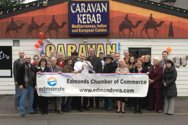 The Edmonds Chamber of Commerce held a ribbon-cutting ceremony for Caravan Kebab, with owner Shahzad Raja, center, doing the honors. The Firdale Village restaurant is located at 9711 Firdale Ave., Edmonds. Phone is  206-546-7999.