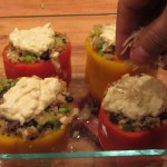 Sprinkle the other 2 tablespoons of Parmesan cheese over the top of the peppers. Place the peppers back in the oven **under the broiler** for 3 to 4 minutes. You want the topping to be brown and bubbly! Make sure to keep an eye on it so they don't burn.