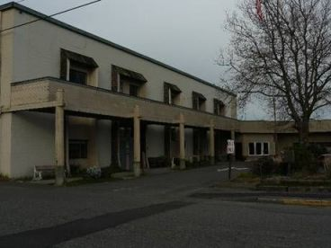 The Senior Center today shows the original two-story warehouse building (left) connected to the old single-story former boat showroom.  The buildings are deteriorating, the first floor is sinking, and significant seismic upgrades are needed. (Photo courtesy of Edmonds Senior Center).