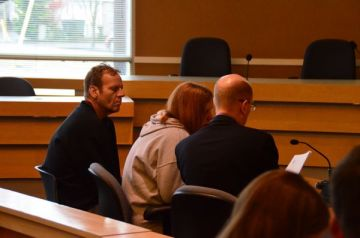 Rose Adams was accompanied by boyfriend George Beutler and attorney John Rongerude to hear Edmonds Municipal Court Judge Douglas Fair rule on their proposed third party caregivers for the five dogs remaining in the Adix shelter at city expense.