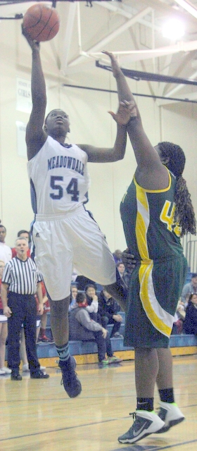 Meadowdale's Ndey Sonko (left) goes up for a shot against Shorecrest's Uju Chibuogwu.