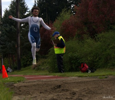 Malik Braxton of Meadowdale takes his turn in the long jump.