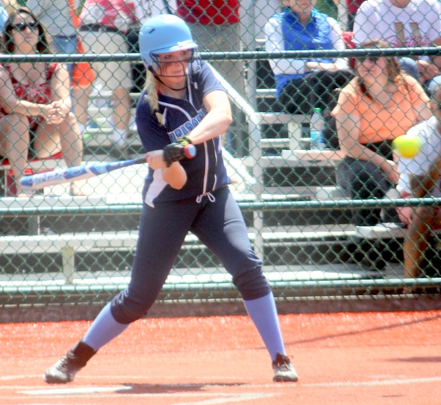 Meadowdale's Haili Taylor swings at a pitch against University.