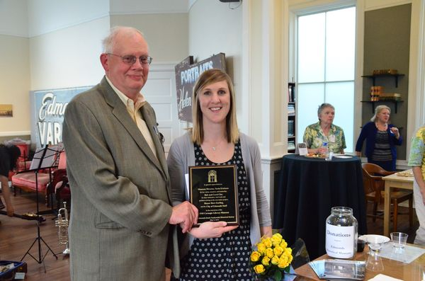 Museum Board President Bill Lambert on Friday presented Museum Director Tarin Erickson with a plaque recognizing her efforts as the driving force behind the restoration work. (Photos by Larry Vogel)