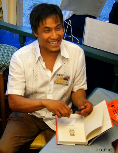 "Tizon, an Edmonds resident, signs copies of ""Big Little Man.""You can read Emily Hill's interview with Tizon here."