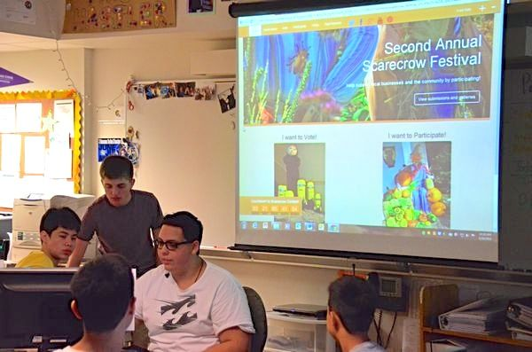 Students in the Edmonds-Woodway High School computer science class demonstrate the website they designed for the annual Edmonds Scarecrow Festival.  L to R, Norton Pengra, Andrew Beasley, Parker McKillup.