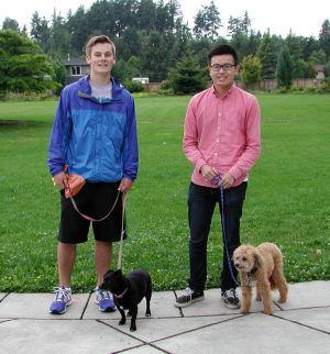 Patrick Matulka with Sadie and Evan Zhao with Duke, ready to go for a walk at Hickman Park.