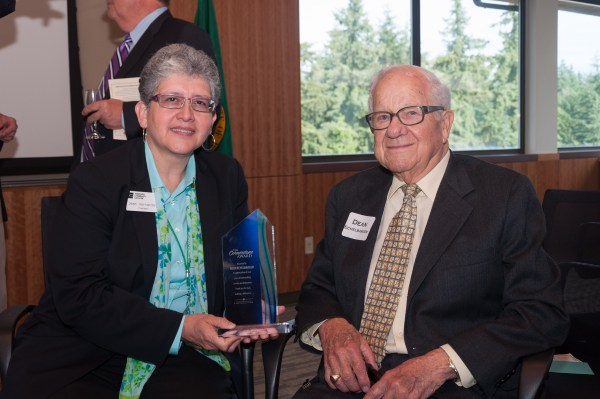 Edmonds CC President Jean Hernandez with Dean Echelbarger, winner of the Cornerstone Award.