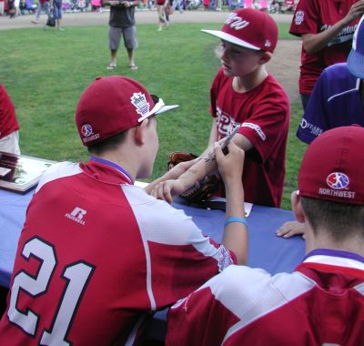 The team signs autographs for fans.