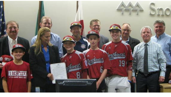 Snohomish County Councilmember Stephanie Wright (in blue shirt) and other councilmembers with Pacific Little League team members Wednesday.