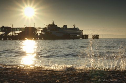 From David Carlos, setting sun over the Edmonds ferry dock  Sunday.
